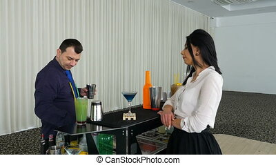 Bartender preparing cocktail for woman at the mobile bar