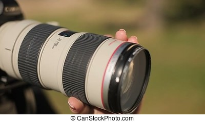 Photographer adjusting focus on camera lens closeup