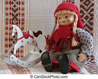 puppet with rocking horse - puppet sitting beside rocking...