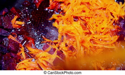 carrots and beets are simmered in a frying pan