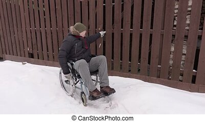 Disabled man on wheelchair trying to enter in the barn