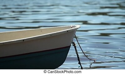 moored rowing boat close-up - Boat on the background of...