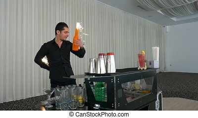 Barman juggling and making flair bartending moves at a bar...
