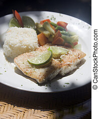 fresh fish fillet with garlic lime rice Central American...