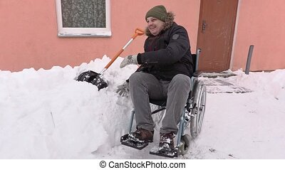 Disabled man on wheelchair snow ball fights