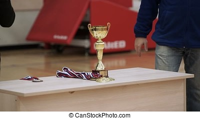 Golden cups for winners in competition