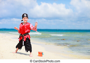 Pirate boy on tropical beach - Cute boy dressed as pirate on...