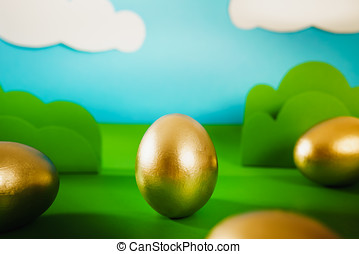 Easter eggs on spring background - gold Easter eggs on a...