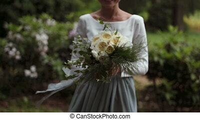Close-up of hands young stylish bride with a beautiful...