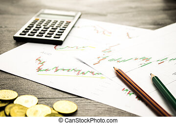 calculator,pencils and coins on graffica the Dow Jones on...