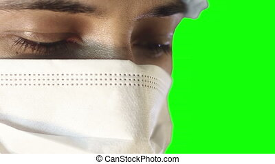 Macro close-up of human eye. A man in a medical mask and cap. busy surgery