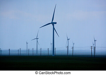 Wind turbines and power poles - Wind farm and power poles on...