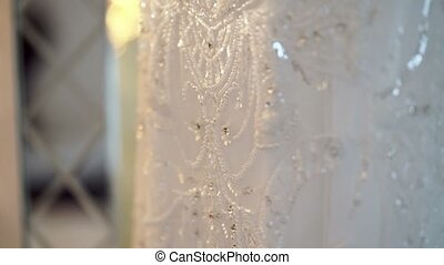 Wedding dress in room at mirror - Wedding white dress in...
