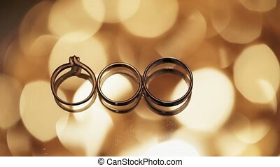 Three wedding rings lighting effects on background