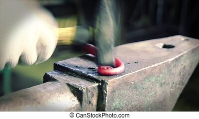 Hot temperature iron bending in a smithery - blacksmith...