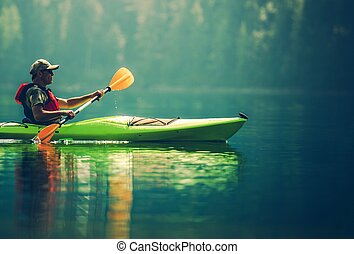 Senior Kayaker on the Lake. Kayak Paddling. Water Sport and...