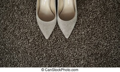Bride wearing shoes on the floor