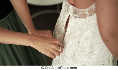 Bridesmaid zip up wedding dress closeup