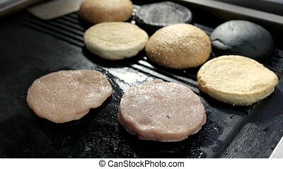 Raw patties and spatula. Pan with burger ingredients....