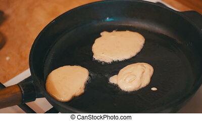 Making Pancake, Crepes, Flapjack on Frying Pan in a Home...