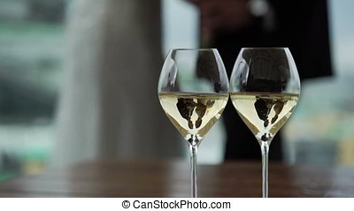Two glasses with champagne - wedding couple in reflection