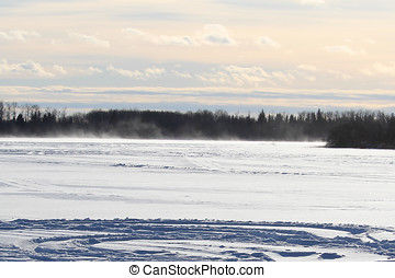 Blowing and Drifting Snow Across an Open Lake