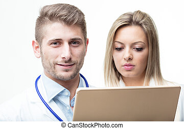 doctors discussing about exam's data with a tablet - doctors...
