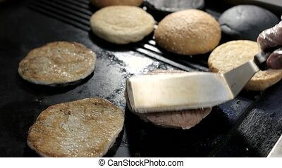 Spatula and burger meat. Hamburger ingredients on pan....