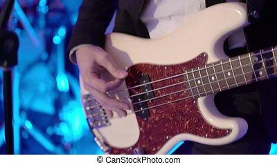 Man playing guitar on concert closeup