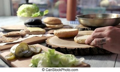Hands making a hamburger.
