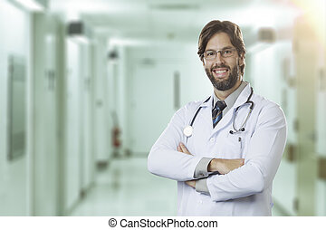 Male doctor in his office - Male doctor at a hospital...