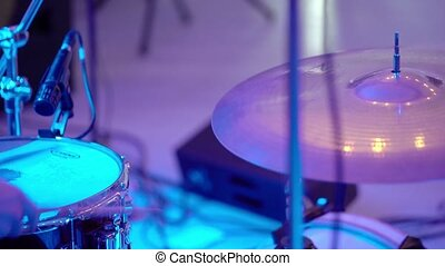 Drummer playing percussion on concert closeup