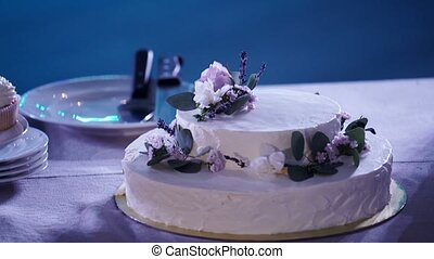 White party cake on table