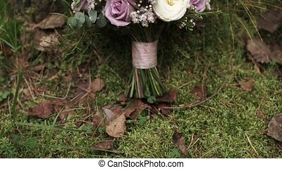 Bridal bouquet outdoors pan shot
