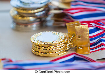 stacks of gold, silver, and bronze medals, selective focus...