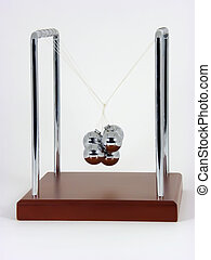 Twisted Newton's Cradle - Macro photo of twisted Newton''s...