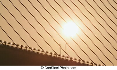 Steel cables of the bridge against the sunset. Bridge in Ha Long city.