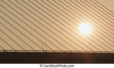 Steel cables of the bridge against the sunset. Bridge in Ha...