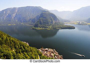village on lake shore - village at foot of mountains on lake...