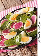 salad of watermelon radishes, eggs, spinach and lettuce mix...