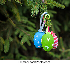 Colourful Easter eggs on Christmas tree green fir-tree