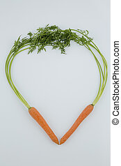 fresh carrots in a heart shape - a heart made of organically...