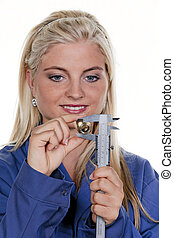 woman as plumber in blue work clothes - young woman as a...