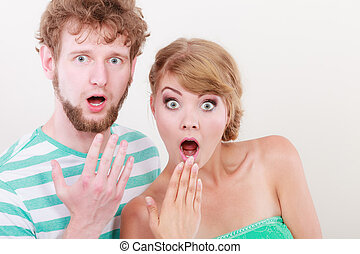 wide eyed couple surprised expression open mouth - Emotional...