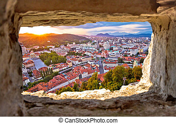Ljubljana sunset through stone window aerial view, capital...