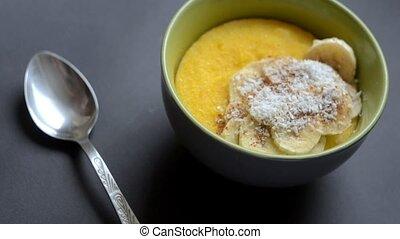 Corn porridge polenta, hominy . Healthy breakfast concept....