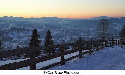 Winter walk mountain sunset village