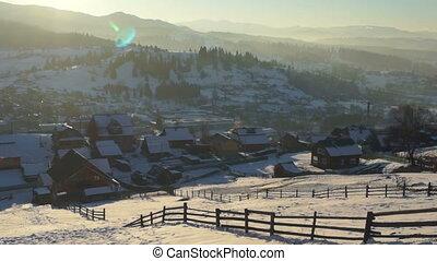 Sunset village winter snow mountains