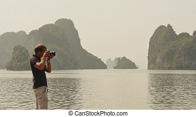 Photographer photographing the nature of Ha Long Bay.