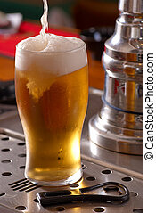 Pint of lager - Serving a pint of lager beer from the draft